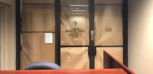 The glass doors to Chicago Alderman Ed Burke's office at City Hall were covered with brown paper, blocking any activity inside Thursday morning.