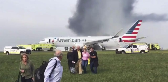 Passengers walk away from an American Airlines jet which aborted a takeoff and caught fire at Chicago's O'Hare International Airport. No serious injuries are reported.