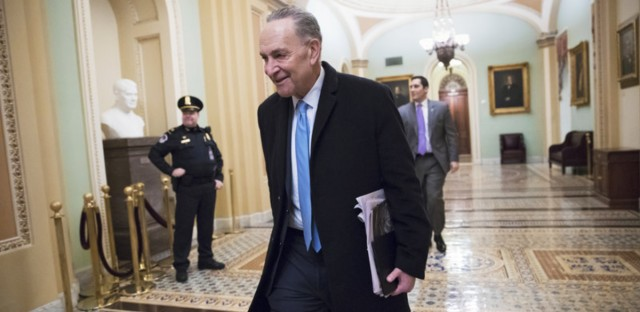 Senate Minority Leader Chuck Schumer, D-N.Y., arrives at the Capitol on Monday, the third day of the government shutdown. With support for a 17-day funding measure, the government is on track to reopen. J. Scott Applewhite/AP