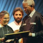 Gandhi's granddaughter Ela, presents former South African President Nelson Mandela, right, the Gandhi King Award for Non-violence at the Parliament of the World's religions in Good Hope centre, Cape Town, Sunday Dec. 5, 1999.