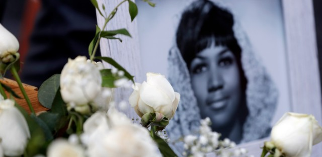 Flowers and pictures are placed on Aretha Franklin's star at the Hollywood Walk of Fame on Aug. 16 in Los Angeles.