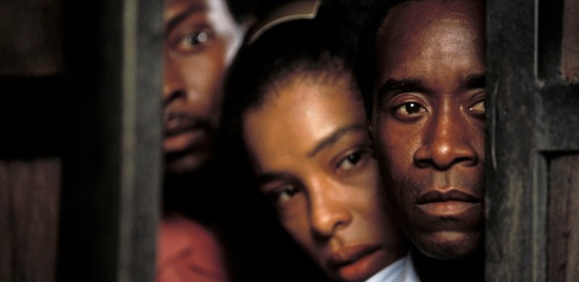 From right: Don Cheadle, Sophie Okonedo and Antonio David Lyons star as Paul, Tatiana, and Thomas in United Artists' drama 'Hotel Rwanda.'
