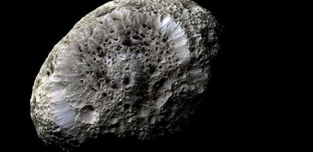 A false-color image of Hyperion reveals crisp details across the strange, tumbling moon's surface. The view was obtained during Cassini's close flyby on Sept. 26, 2005.