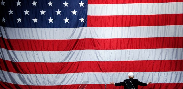 Republican presidential candidate Donald Trump turns to the American flag at a campaign rally in Sterling Heights, Mich. on Nov. 6, 2016.