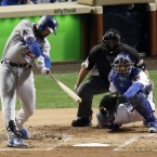Los Angeles Dodgers' Adrian Gonzalez (23) hits a home run during the second inning of Game 2 of the National League baseball championship series against the Chicago Cubs, Sunday, Oct. 16, 2016, in Chicago.