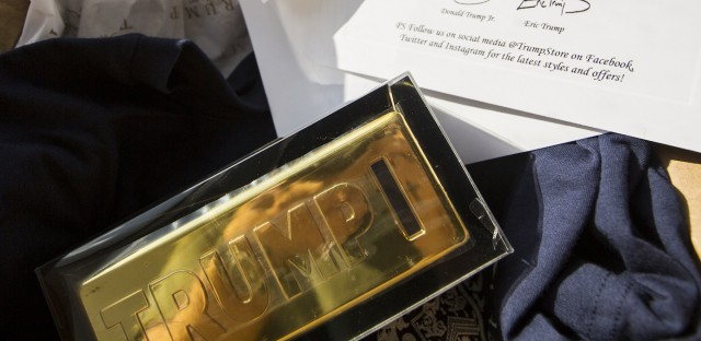 "A $25 Trump ""gold coin bar bank"" purchased from TrumpStore.com comes with a thank you card signed by Donald Trump's sons, Donald Trump Jr. and Eric Trump."