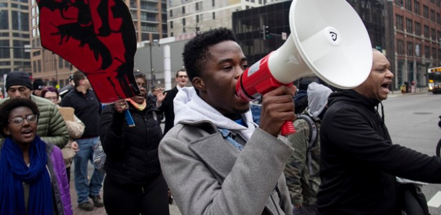 Protestors marched in downtown Chicago on Friday in response to the grand jury's decision not to indict a police officer in Eric Garner's death in New York.
