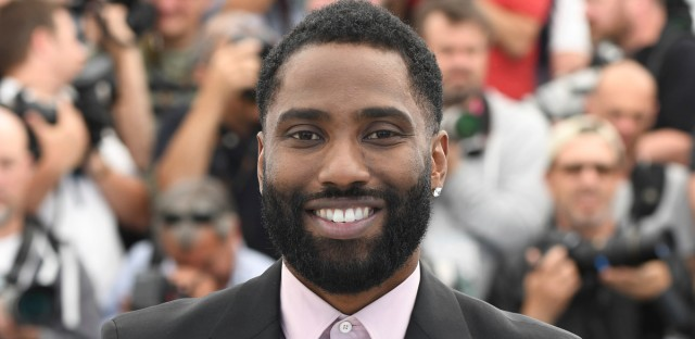 Actor John David Washington poses for photographers during a photo call for the film 'BlacKkKlansman' at the 71st international film festival in Cannes, France, on Tuesday, May 15, 2018.