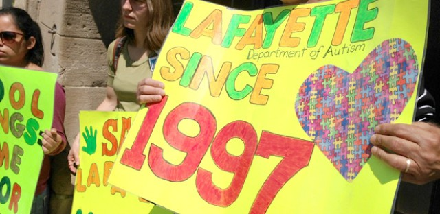 Parents outside Lafayette Elementary Monday protest CPS's push to enroll students in new programs. Lafayette is home to one of the district's only autism programs and special needs parents are worried about the transition to different schools.