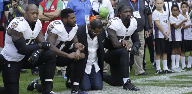Baltimore Ravens outside linebacker Terrell Suggs (from left), Mike Wallace, former player Ray Lewis and inside linebacker C.J. Mosley kneel during the playing of the national anthem before an NFL football game between the Jacksonville Jaguars and the Ravens at Wembley Stadium in London on Sunday.