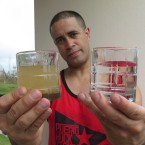 Richard Colón, better known by his stage name Crazy Legs at his home in Isabela, Puerto Rico, shows the before-and-after of the water filtration system he's helping deliver to people in remote areas.
