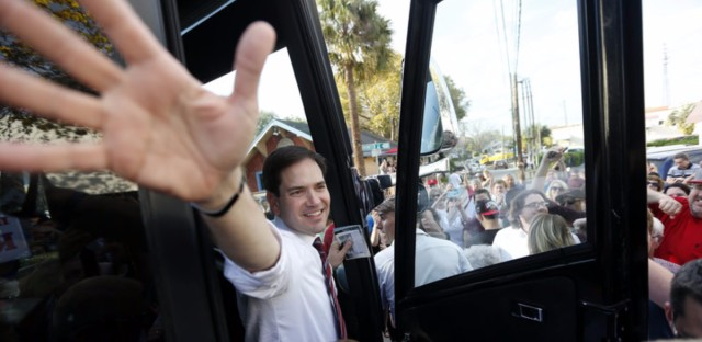 Marco Rubio waves as he boards his bus after a campaign stop in Lakeland, Fla., on Saturday.