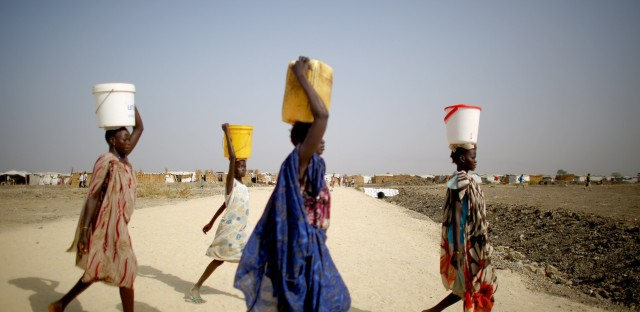 With severe water shortages at the displaced persons camp, women and girls at times have to walk up to a mile to fetch water.