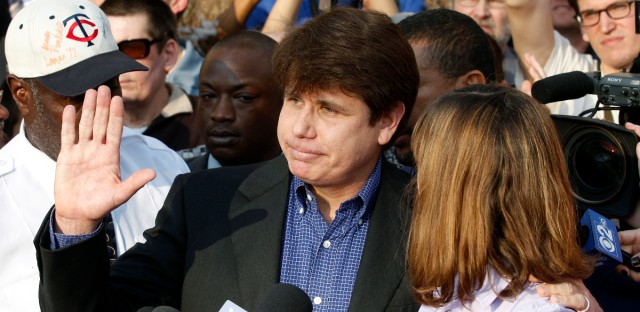 In this March 14, 2012 file photo, former Illinois Gov. Rod Blagojevich, with his wife Patti at his side, speaks to the media in Chicago before reporting to federal prison in Denver. President Donald Trump says he is considering commuting the sentence of ex- Gov. Blagojevich and pardoning Martha Stewart. The comments came aboard Air Force One on Thursday, May 31, 2018, after he tweeted that he planned to pardon conservative commentator Dinesh D'Souza. Blagojevich, a Democrat, began serving his 14-year prison sentence on corruption convictions in 2012.