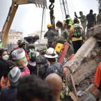 Volunteers remove rubble as they search for survivors in a flattened building in Mexico City on Wednesday.