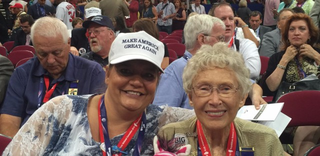 Delegates, and roomies, Maria Hough and Stella Kozanecki on the convention floor. Their third roommate, Lanna Logan, is an alternate delegate so she has to sit in the stands. But the ladies are constantly texting throughout the convention events.