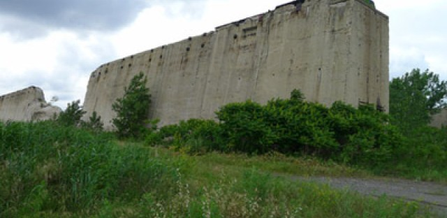The massive ore walls on the former U.S. Steel South Works site are remnants of the land's industrial past.