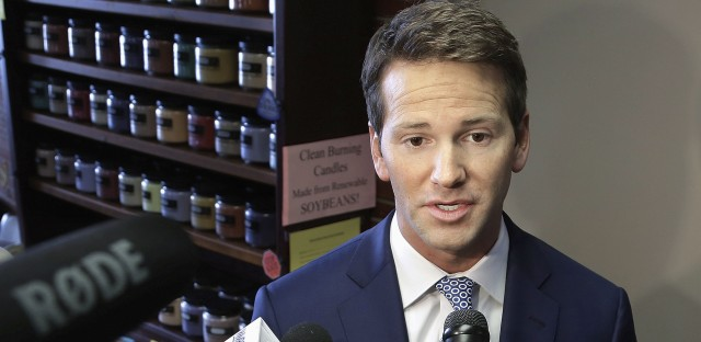 Former U.S. Rep. Aaron Schock speaks to reporters in Peoria, Ill., in 2015.