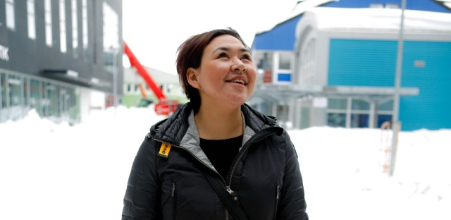 "Greenland native Nina-Vivi Andersen, pictured in downtown Nuuk, Greenland, has her own perspective on the word Eskimo: ""I don't mind to be called Eskimo — it is neutral for me. But when I saw an ice cream store in London with a name — Eskimo — it felt weird. But I feel weird to be called Inuit, too. I'm just a Greenlander."""
