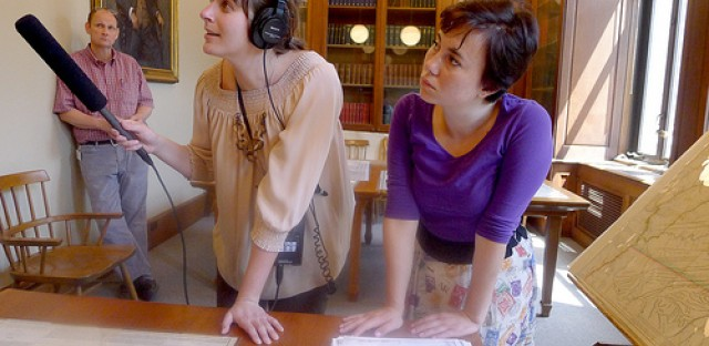 Reporter Robin Amer, left, and curious citizen Miriam Reuter, right, at the Newberry checking out early maps of Chicago.