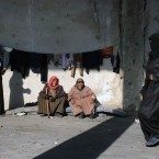 This image released by the International Committee for the Red Cross (ICRC) shows Syrians who were displaced with their families from eastern Aleppo gathering at the collective shelter, in the village of Jibreen south of Aleppo, Syria, Monday, Dec. 12, 2016. Syria's military said Monday it has regained control of 98 percent of eastern Aleppo, as government forces close in the last remaining sliver of a rebel enclave packed with fighters as well as tens of thousands of civilians.