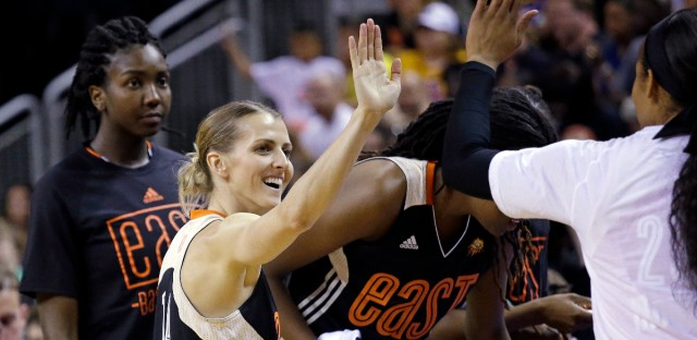 Eastern Conference's Allie Quigley, of the Chicago Sky, is congratulated by teammates after winning the 3-point contest at the WNBA All-Star basketball game Saturday, July 22, 2017, in Seattle.