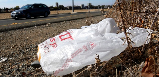 A plastic bag sits along a roadside in Sacramento, Calif. Chicago has overturned its partial ban on single-use plastic bags.