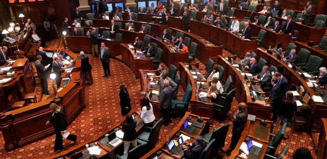 Illinois lawmakers debate legislation while on the House floor during session at the Illinois State Capitol Thursday, June 30, 2016, in Springfield, Ill. If Illinois enters another year without a budget by Thursday, cash will stop flowing to local 911 centers, preventative health screenings and tuition grants for low-income college students.