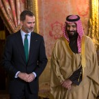 Spain's King Felipe, left, his wife Queen Letizia, right, and Saudi Crown Prince Mohammed bin Salman Al Saud stand to welcome guests before a lunch at the Royal Palace in Madrid, Thursday, April 12, 2018.