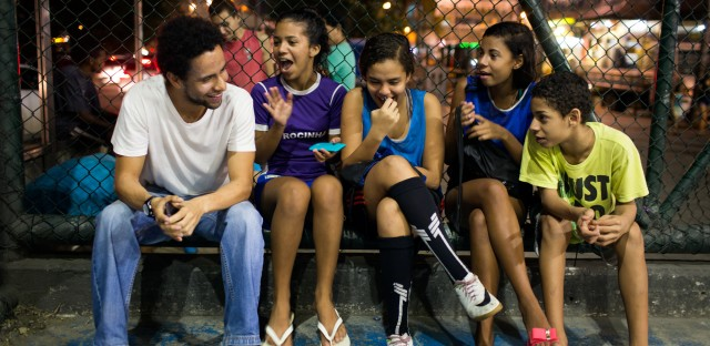 Guilherme Silva (left) is a volunteer coach with Estrela Sports, which trains both boys and girls to play soccer. He's sitting with (from left) Victoria Silva Rodrigues, 13, Lahis Maria Ramos Veras, 14, and Milena Medeiros dos Santos, 16, and her brother Vinicius Medeiros, 12.