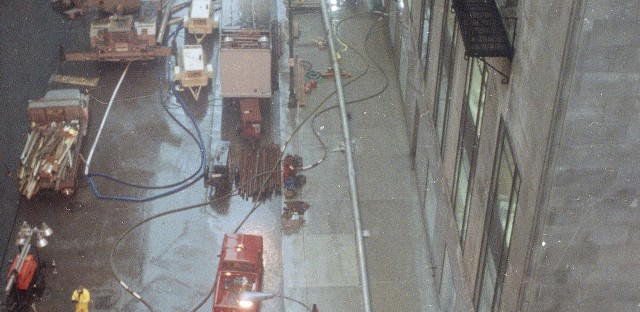Water is pumped out of the basement of the Chicago Board of Trade, right, on April 15, 1992, as businesses tried to cope with flooding in the Loop.