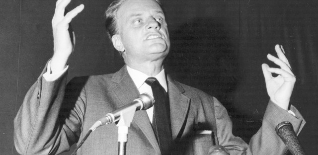 Billy Graham preaching at one of his rallies in 1966. (Evening Standard/Getty Images)