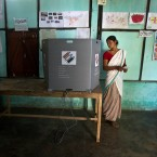 An Indian Mishing tribal woman, looks back to ensure her vote has been cast as she prepares to leave the voting compartment during the first phase of general elections in Majuli, Assam, India, Thursday, April 11, 2019. Voters in 18 Indian states and two Union Territories began casting ballots on Thursday, the first day of a seven-phase election staggered over six weeks in the country of 1.3 billion people. The election, the world's largest democratic exercise, is seen as a referendum on Prime Minister Narendra Modi and his Bharatiya Janata Party.