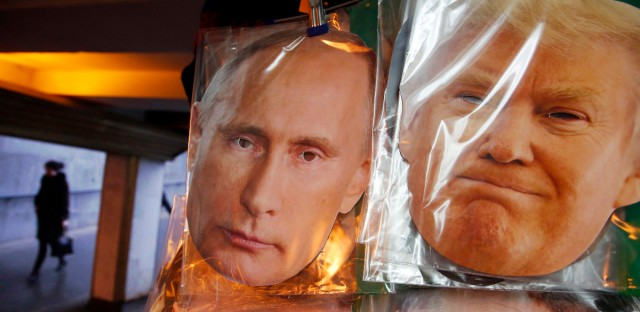 Face masks depicting Russian President Vladimir Putin and U.S. President-elect Donald Trump hang for sale at a souvenir street shop in St.Petersburg, Russia, Friday, Dec. 23, 2016.