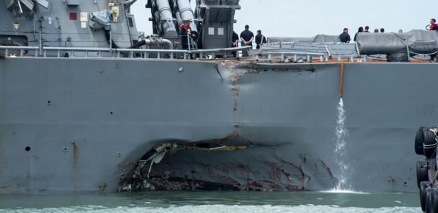 Damage to the port side is visible as the guided-missile destroyer USS John S. McCain steers toward Changi naval base in Singapore following a collision with the merchant vessel Alnic MC on Monday.