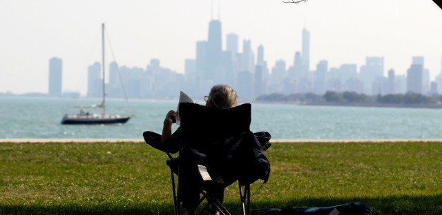 A woman reads at Chicago's Montrose beach in August 2011. (AP Photo/Nam Y. Huh)