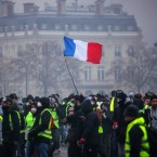 Demonstrators gather near the Arc de Triomphe during a protest on Saturday in Paris. -/AFP/Getty Images