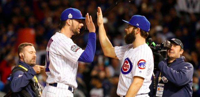 Chicago Cubs' Kris Bryant, left, celebrates with Jake Arrieta after Game 5 of the Major League Baseball World Series against the Cleveland Indians, Sunday, Oct. 30, 2016, in Chicago. The Cubs won 3-2 as the Indians lead the series 3-2.