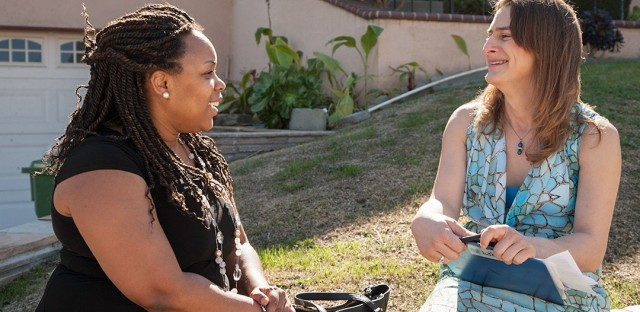 Nancy Williams, right, who is transgender, talks with a voter as part of a canvassing effort in Los Angeles.