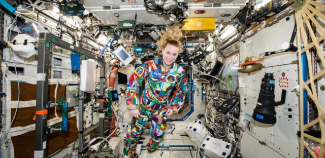 NASA astronaut Kate Rubins floats in the International Space Station in September 2016, wearing a spacesuit decorated by patients recovering at the MD Anderson Cancer Center.