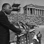 "Dr. Martin Luther King addresses a crowd estimated at 70,000 at a civil rights rally in Chicago's Soldier Field on June 21, 1964. King told the rally that congressional approval of civil rights legislation heralds ""The dawn of a new hope for the Negro."""