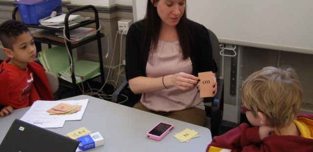 Teacher Beth Herdering uses flashcard to help her students at Hyde Park Day School in Chicago with learning disabilities overcome their reading issues.