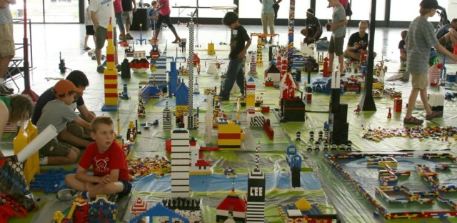 Children and adults alike build a city out of Legos in IIT's Crown Hall in 2011. The city will be built anew this weekend.