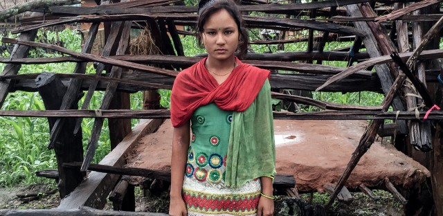 Kamala B.K. in front of her menstruation shed.