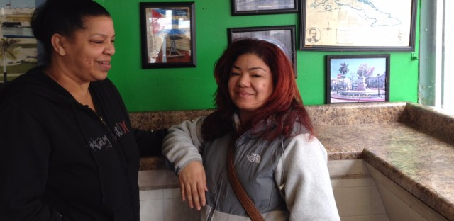 Magdalena Rodriguez (left) and her daughter Isis wait for sandwiches at Marianao's Cuban sandwich shop. Magdalena left Cuba as a child and is skeptical changes are coming.