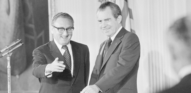 U.S. Secretary of State Henry Kissinger, left, and President Richard M. Nixon are shown after Kissinger was sworn in in the East Room of the White House on Sept. 22, 1973.