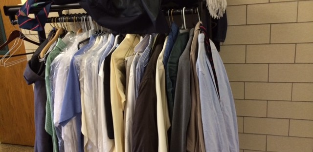 Teenagers who spend their days at Precious Blood Ministries in Chicago's Back of the Yards neighborhood borrow dress clothes from a clothes rack there before court appearances. Father David Kelly at Precious Blood says a panel of Illinois lawmakers should consider community organizations when looking at ways to reduce the prison population.