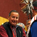 Grand Chief Stewart Phillip shakes the hands of First Nation leaders after they sign the Treaty Alliance Against Tar Sands Expansion during an announcement on oil sands pipelines Thursday at the Musqueam Community Centre in Vancouver, British Columbia.
