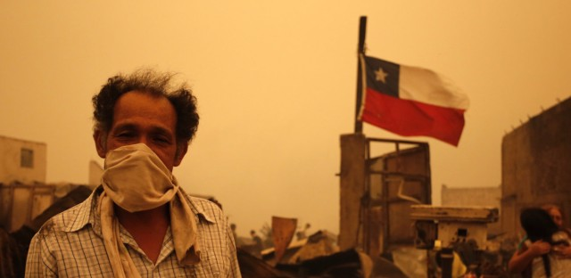 A man in Santa Olga, Chile, as the town was consumed by flames on Thursday.