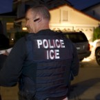ICE agents wait outside of the home of a suspect in 2012 in San Diego.